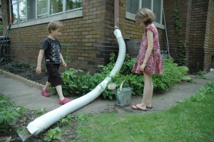 kids with rain barrel
